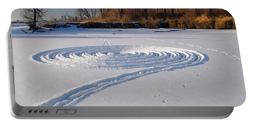 Footprint Portable Battery Charger featuring the photograph Footprint Snow Ring On A Frozen River In Winter At The Toronto I by Reimar Gaertner
