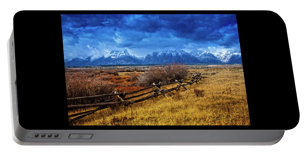 Grand Tetons Portable Battery Charger featuring the photograph Forgotten Fence by Richard Cronberg
