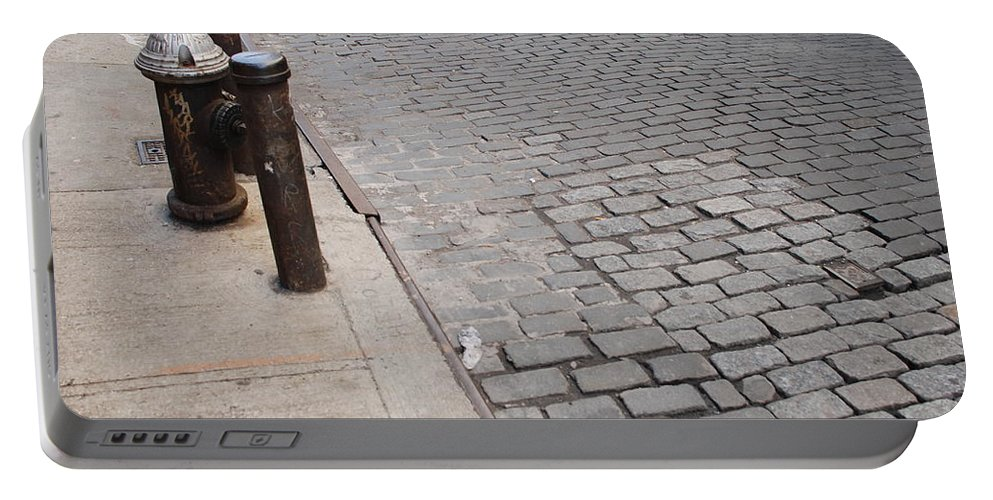 Architecture Portable Battery Charger featuring the photograph Forgotten N Y by Rob Hans