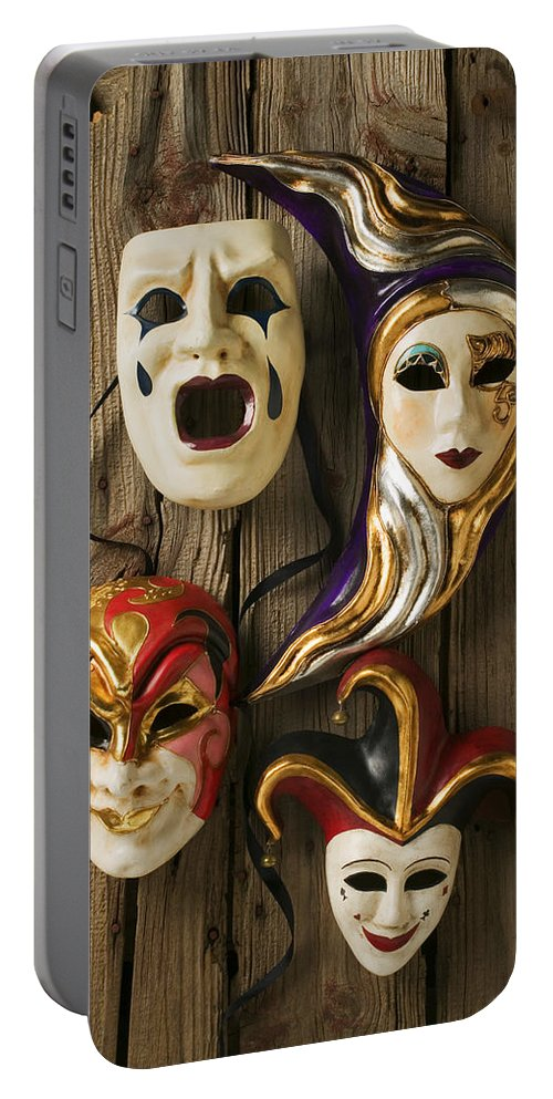 Mask Portable Battery Charger featuring the photograph Four Masks by Garry Gay