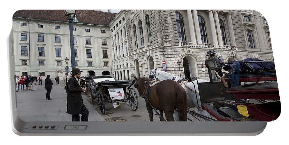 Vienna Portable Battery Charger featuring the photograph Friends Are Buyable by Madeline Ellis