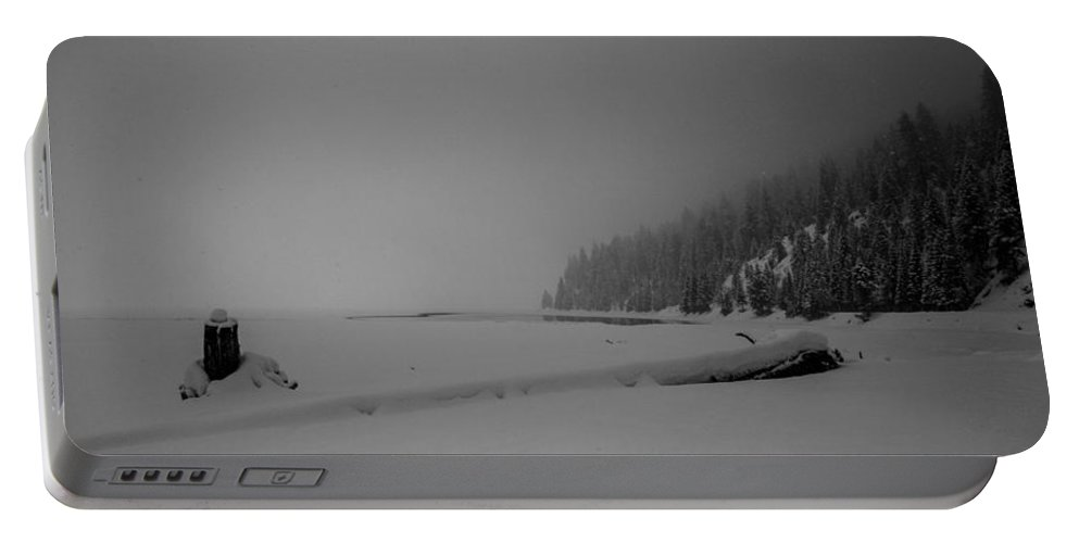 Mccall Portable Battery Charger featuring the photograph Frozen Lakeshore by Angus Hooper Iii