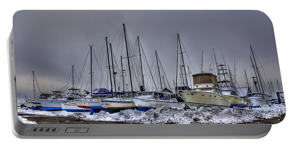 Boat Portable Battery Charger featuring the photograph Frozen Waves by Evelina Kremsdorf