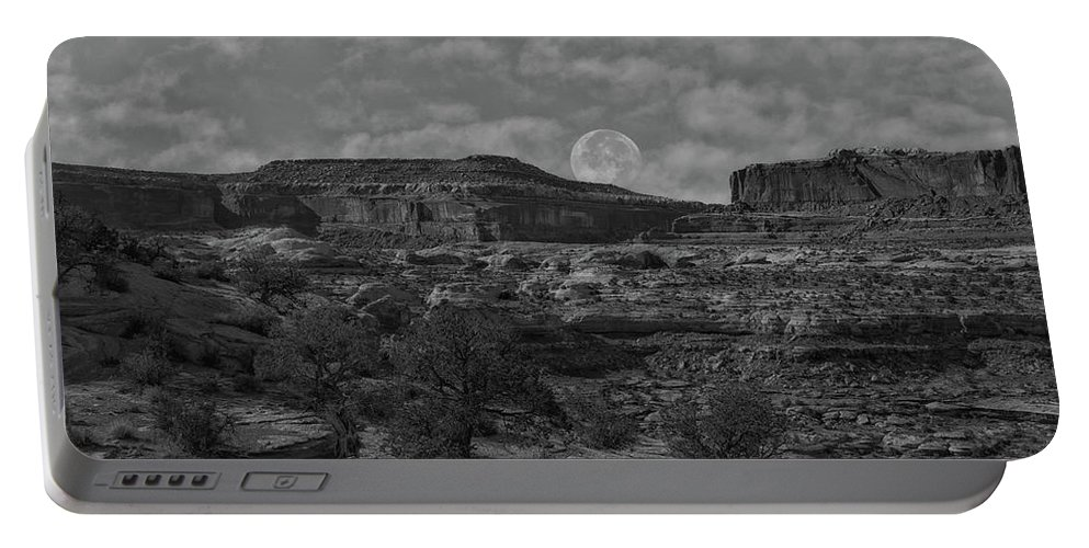 Canyonlands Portable Battery Charger featuring the photograph Full Moon Over Red Cliffs Bw by Mitch Johanson