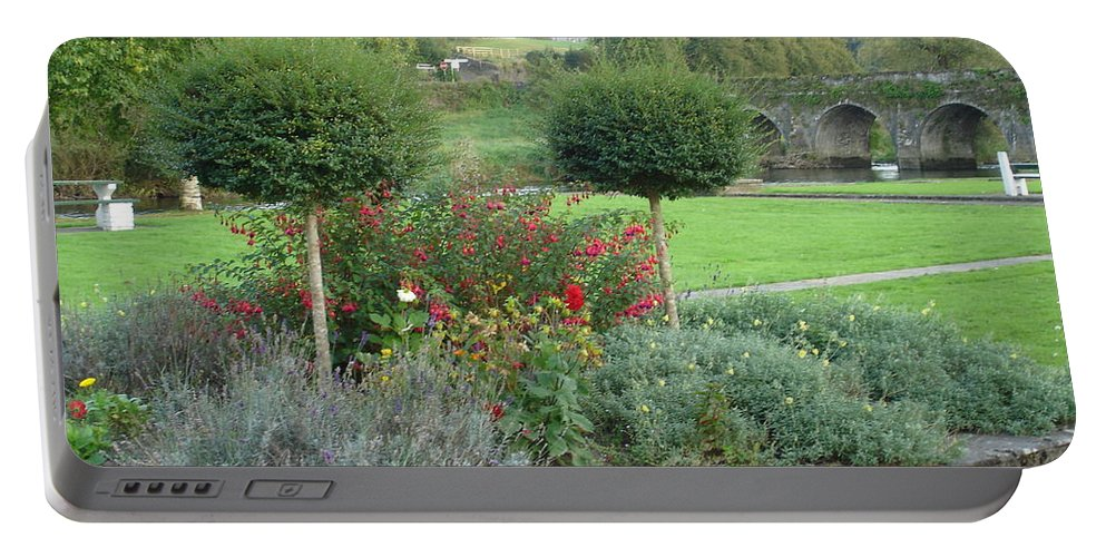 Inistioge Portable Battery Charger featuring the photograph Garden On The Banks Of The Nore by Kelly Mezzapelle