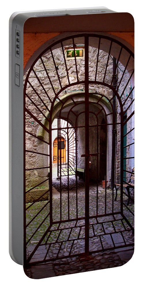 Gate Portable Battery Charger featuring the photograph Gated Passage by Tim Nyberg