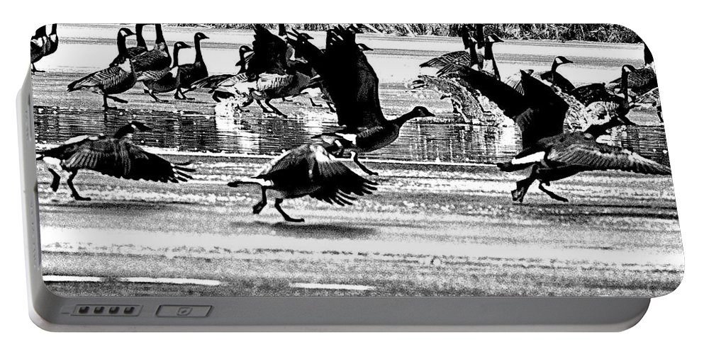Geese Portable Battery Charger featuring the photograph Geese On Ice Taking Flight by Bill Cannon