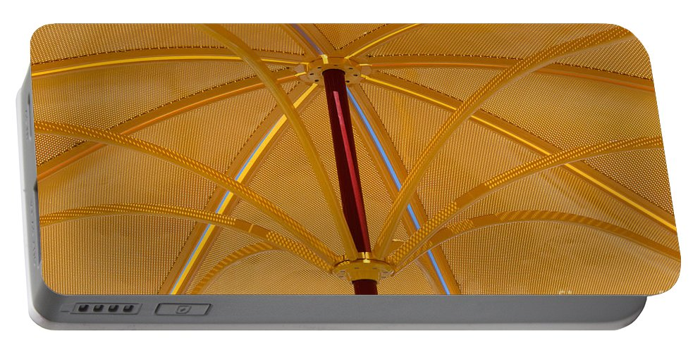 Umbrella Portable Battery Charger featuring the photograph Golden Metal Parasol Umbrella by Merrimon Crawford