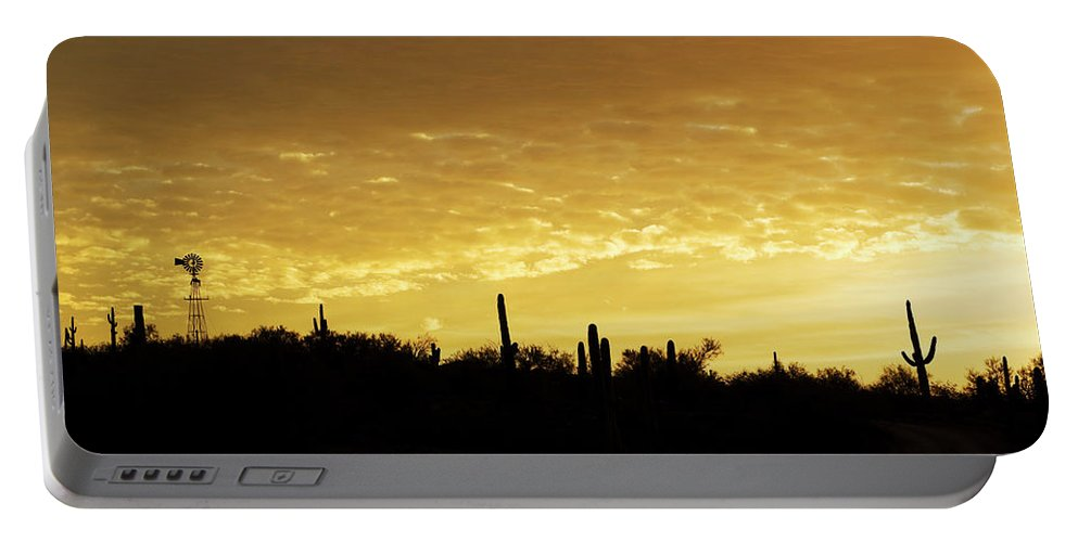 Sunrise Portable Battery Charger featuring the photograph Golden Sunrise by Phyllis Denton