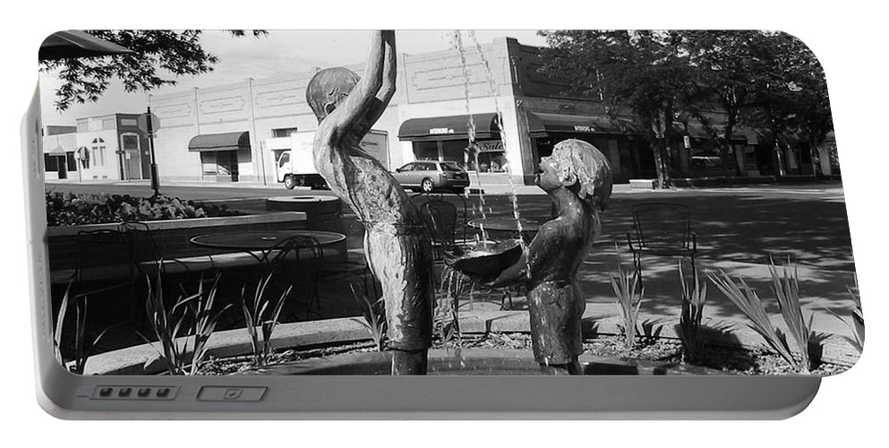 Children Playing Sculpture Portable Battery Charger featuring the photograph Grand Junction Co by Tommy Anderson