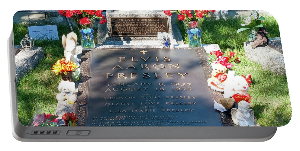 Grave Portable Battery Charger featuring the photograph Grave Site At Graceland The Home Of Elvis Presley, Memphis, Tennessee by Timothy Wildey