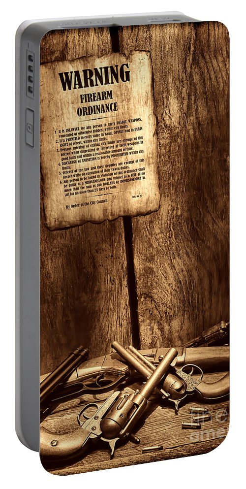 Western Portable Battery Charger featuring the photograph Gun Control by American West Legend By Olivier Le Queinec