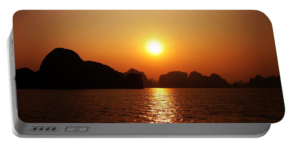 Orange Portable Battery Charger featuring the photograph Ha Long Bay Sunset by Oliver Johnston