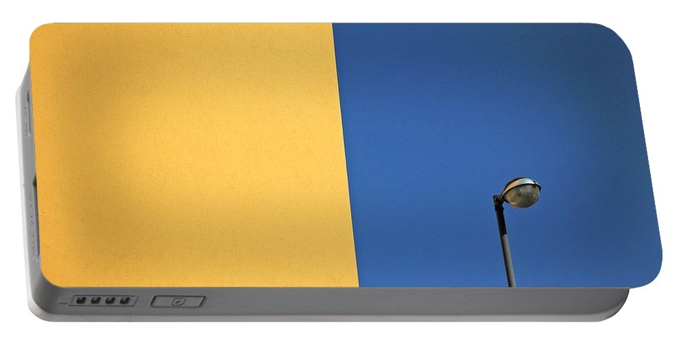 Urban Portable Battery Charger featuring the photograph Half Yellow Half Blue by Silvia Ganora
