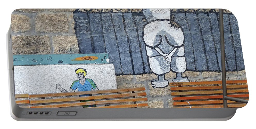 Handala Portable Battery Charger featuring the photograph Handala And The Wall by Munir Alawi
