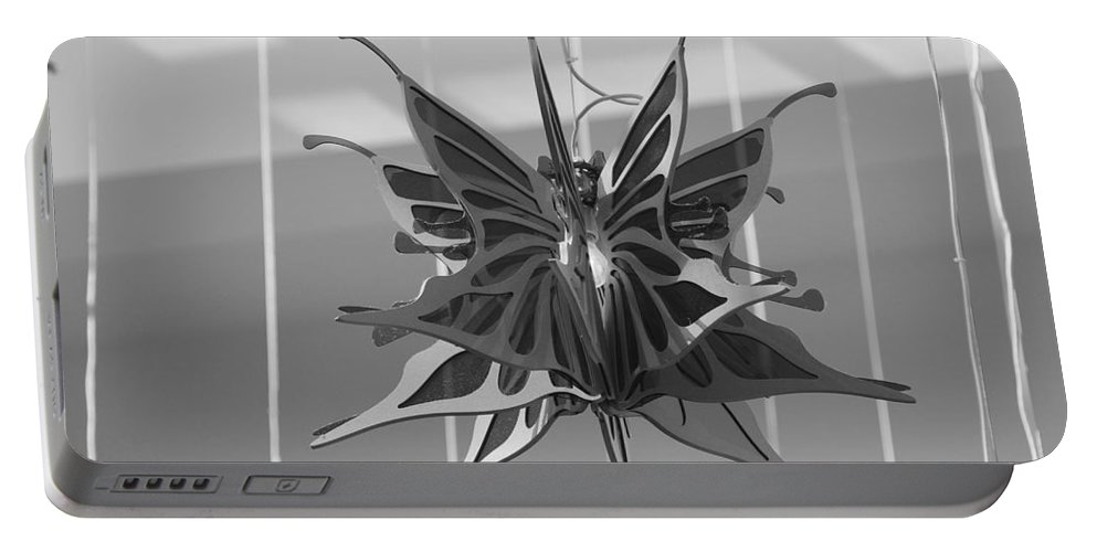 Black And White Portable Battery Charger featuring the photograph Hanging Butterfly by Rob Hans