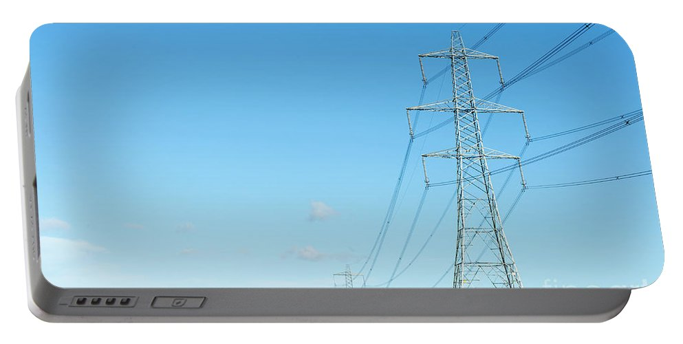 Engeland Portable Battery Charger featuring the digital art Hardly A Cloud In The Sky As Pylons Distribute Energy Through The Region. by Richard Wareham