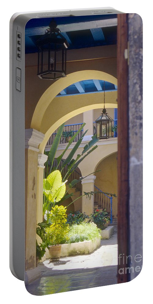 Havana Cuba Building Buildings Structure Structures Architecture City Cities Cityscape Cityscapes Arch Arches Courtyard Courtyards Plant Plants Portable Battery Charger featuring the photograph Havana Courtyard by Bob Phillips