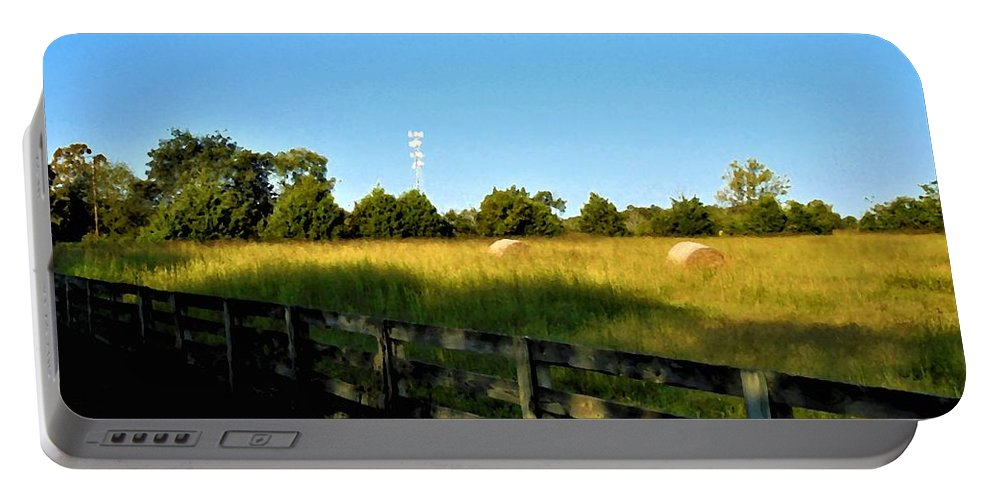 Field Portable Battery Charger featuring the photograph Hayfield With Distant Cell Tower by Michael Potts