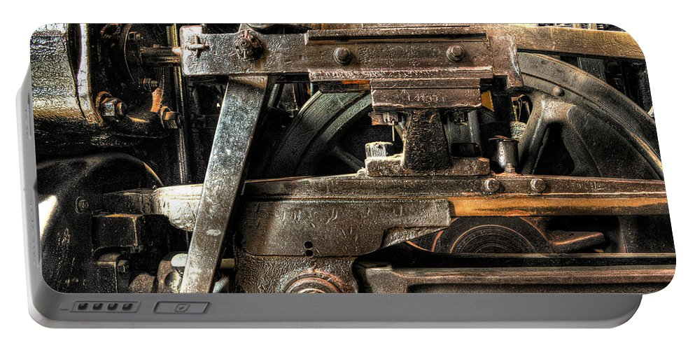Train Portable Battery Charger featuring the photograph Heavy Wheel by Scott Wyatt