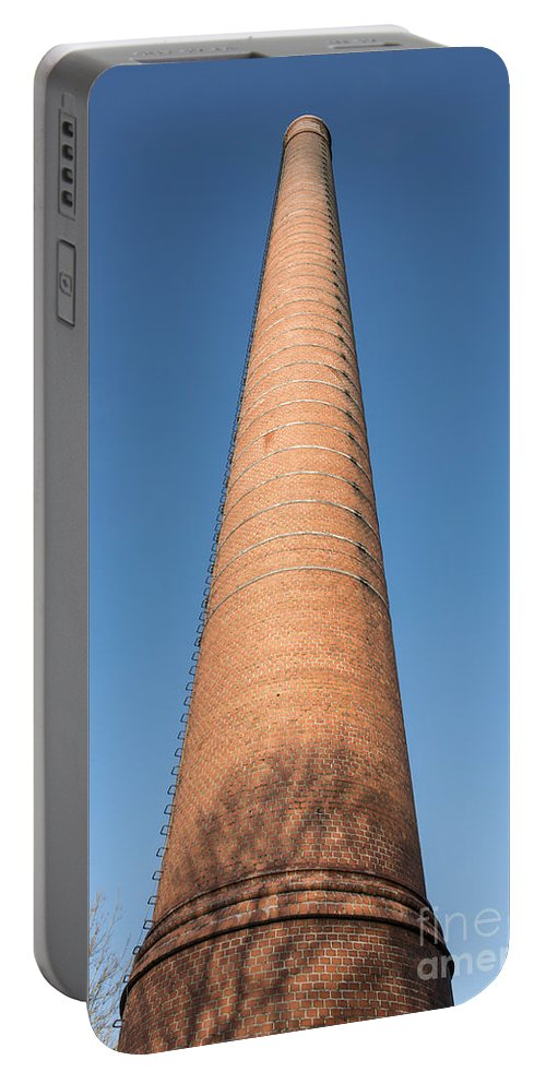 Chimney Portable Battery Charger featuring the photograph High Chimney At Blue Sky by Compuinfoto