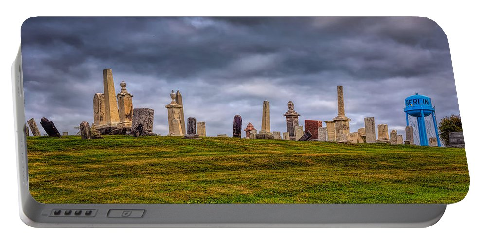 Sky Portable Battery Charger featuring the photograph Hilltop Graveyard by John M Bailey