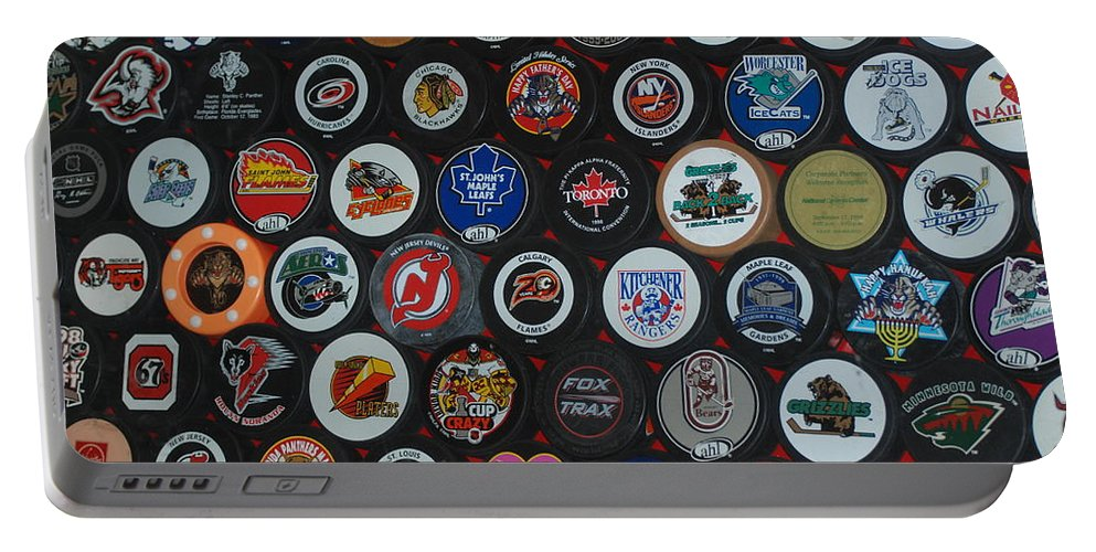 Pop Art Portable Battery Charger featuring the photograph Hockey Pucks by Rob Hans