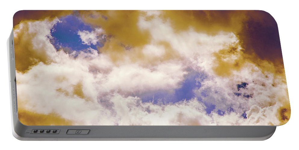 Cloud Portable Battery Charger featuring the photograph Hole In The Cloud by Michael Frizzell