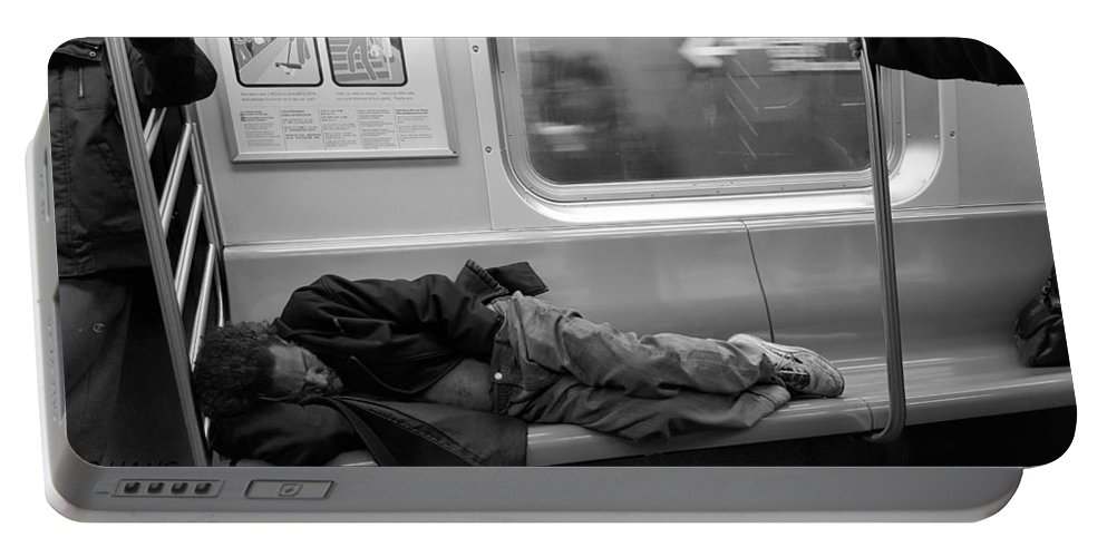 Urban Portable Battery Charger featuring the photograph Homeless In Motion In Black And White by Rob Hans