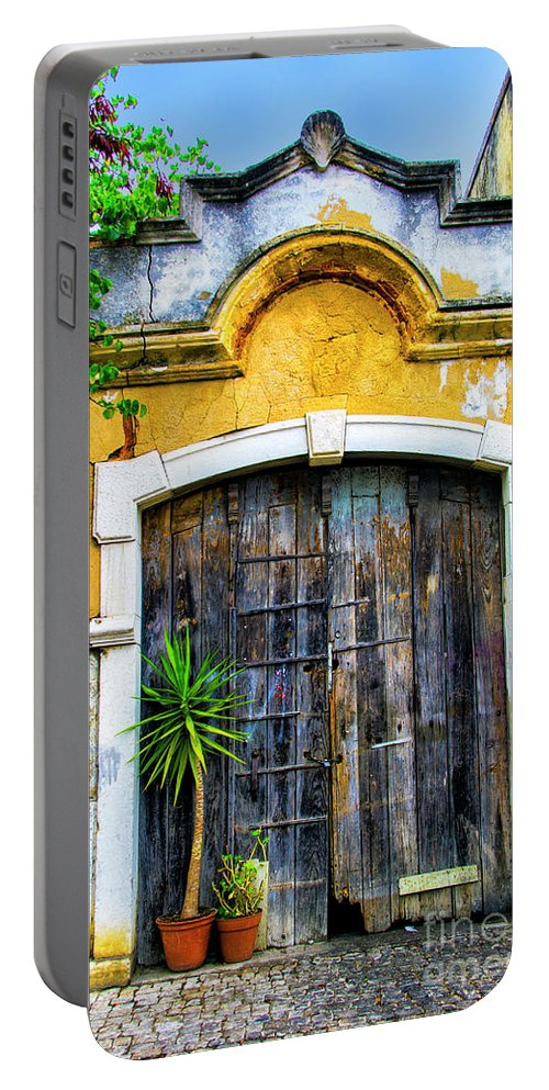 Setubal Portable Battery Charger featuring the photograph Hope Grows by Roberta Bragan