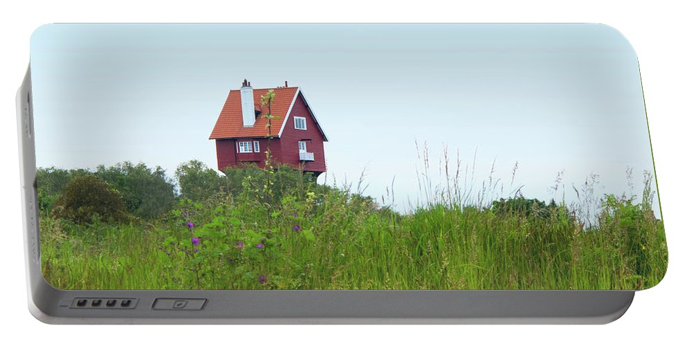 Thorpeness Portable Battery Charger featuring the photograph House In The Clouds by Ann Horn