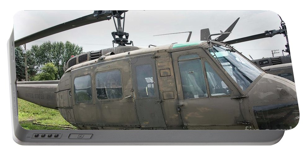 Helicopter Portable Battery Charger featuring the photograph Huey - 1 by David Bearden