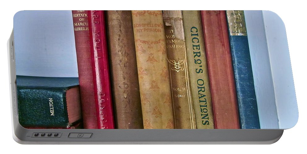 Photograph Of Books Portable Battery Charger featuring the photograph I Dare You Et Al. by Gwyn Newcombe
