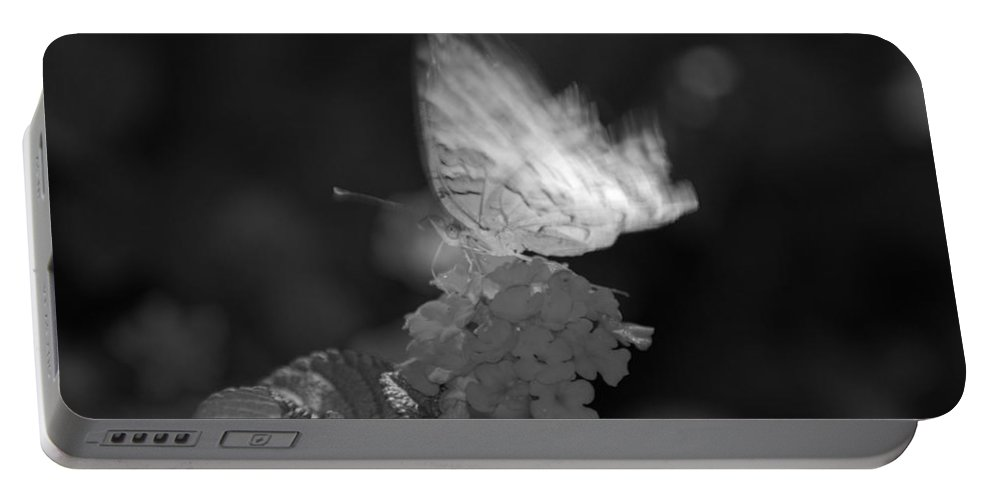 Black And White Portable Battery Charger featuring the photograph In Motion by Rob Hans