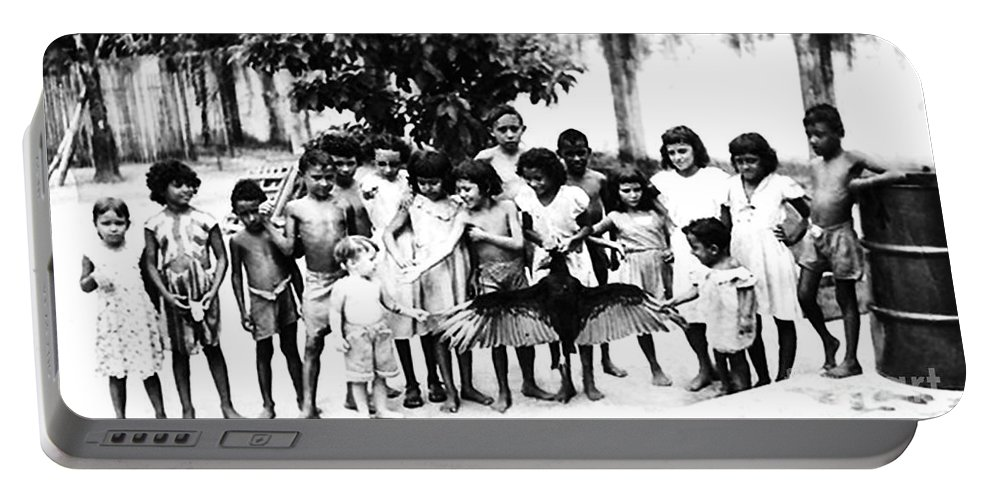 Children Portable Battery Charger featuring the photograph In The Amazon 1953 by W E Loft