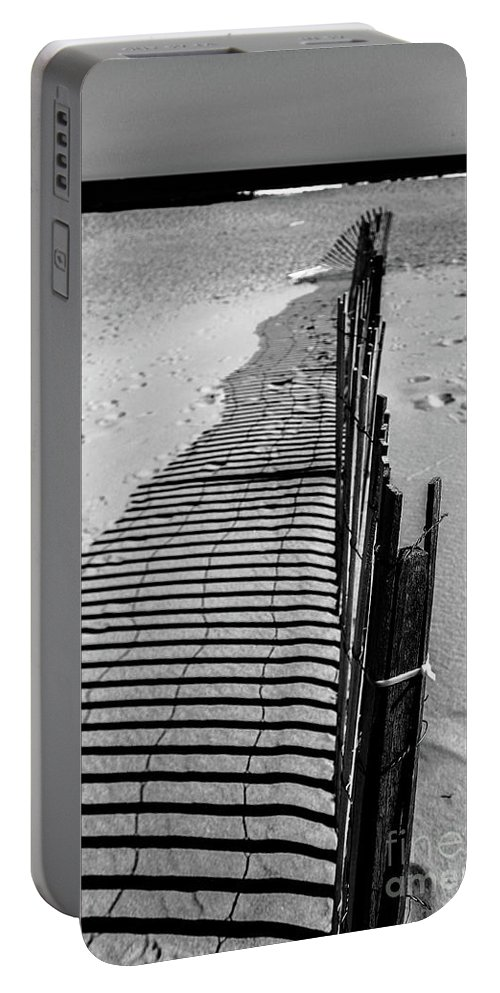 Fence Portable Battery Charger featuring the photograph In The Sand by Colleen Kammerer