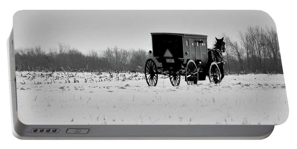 Amish Portable Battery Charger featuring the photograph In The Snow by David Arment