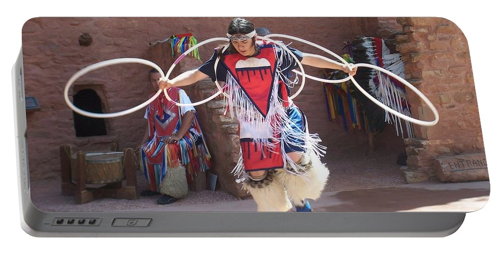 Indian Dancer Portable Battery Charger featuring the photograph Indian hoop dancer by Anita Burgermeister