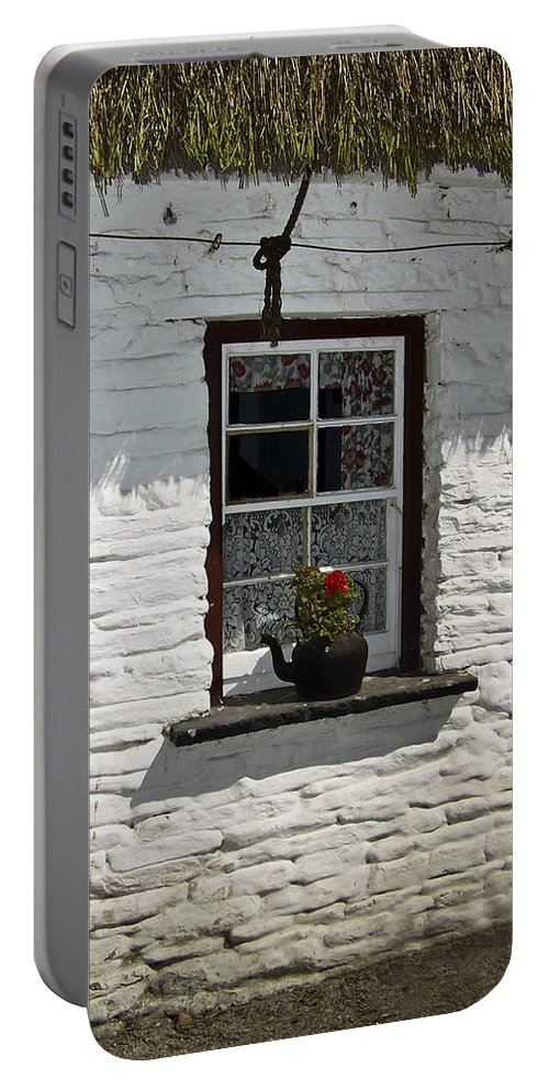 Irish Portable Battery Charger featuring the photograph Irish Kettle Of Geraniums County Cork Ireland by Teresa Mucha
