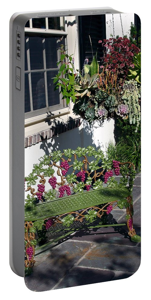 Green Iron Bench Portable Battery Charger featuring the photograph Iron Garden Bench by Sally Weigand