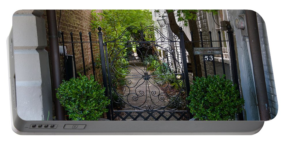 Entrance Portable Battery Charger featuring the photograph Iron Gate Alley by Dale Powell
