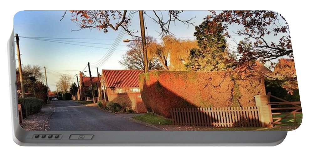 Kingslynn Portable Battery Charger featuring the photograph It Looks Like We've Found Our New Home by John Edwards