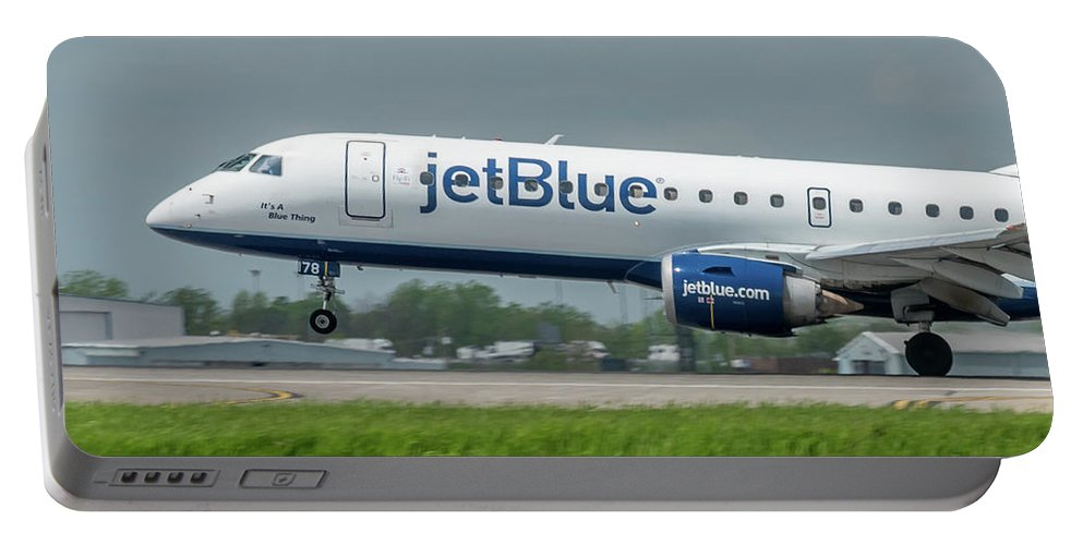 Aviation Portable Battery Charger featuring the photograph It's A Blue Thing by Guy Whiteley