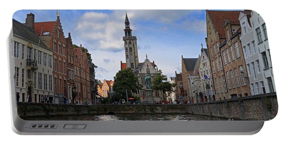 Poortersloge Portable Battery Charger featuring the photograph Jan Van Eyck Square With The Poortersloge From The Canal In Bruges by Louise Heusinkveld