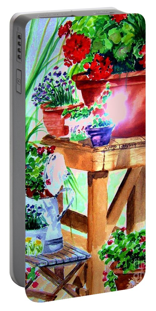 Flowers.geraniums Portable Battery Charger featuring the painting Julie's Deck by Sandy Ryan