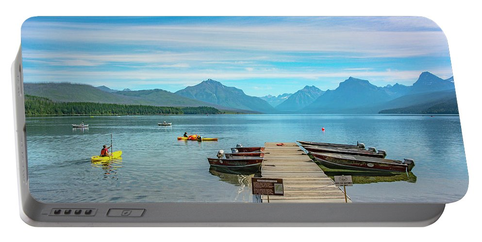 Montana Portable Battery Charger featuring the photograph July 4th on Lake McDonald by Bryan Spellman
