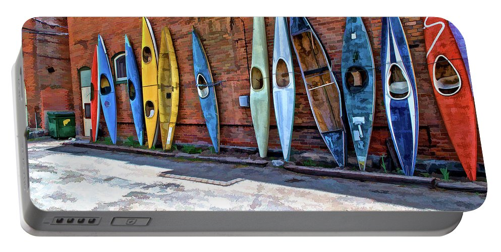 Kayak Portable Battery Charger featuring the photograph Kayaks On A Wall by Charles Muhle