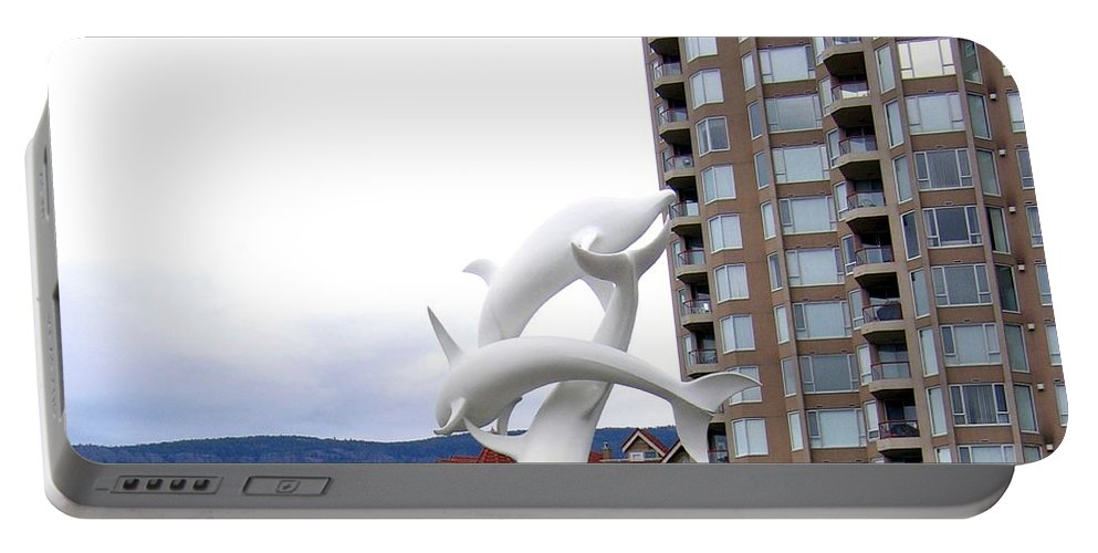 Kelowna Portable Battery Charger featuring the photograph Kelowna Dolphins by Will Borden