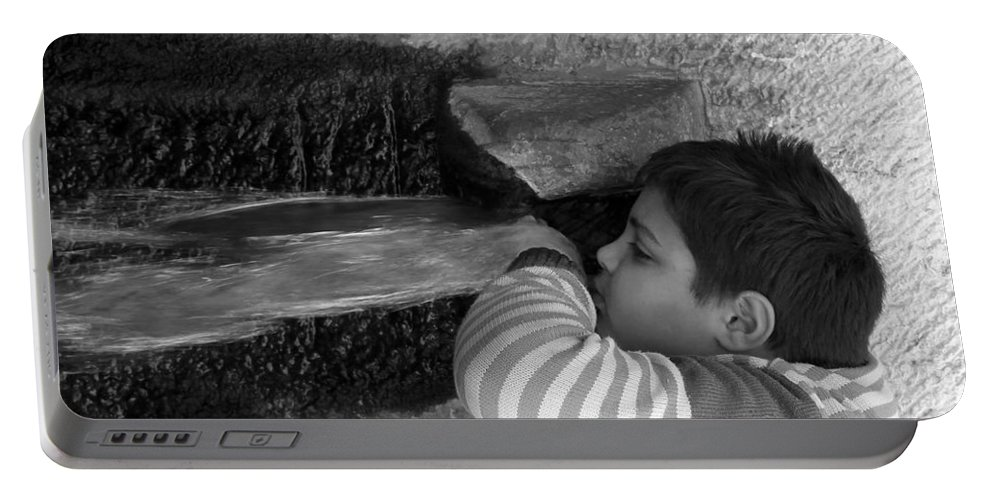 Fountain Portable Battery Charger featuring the photograph Kid Drinking From The Fountain by Munir Alawi