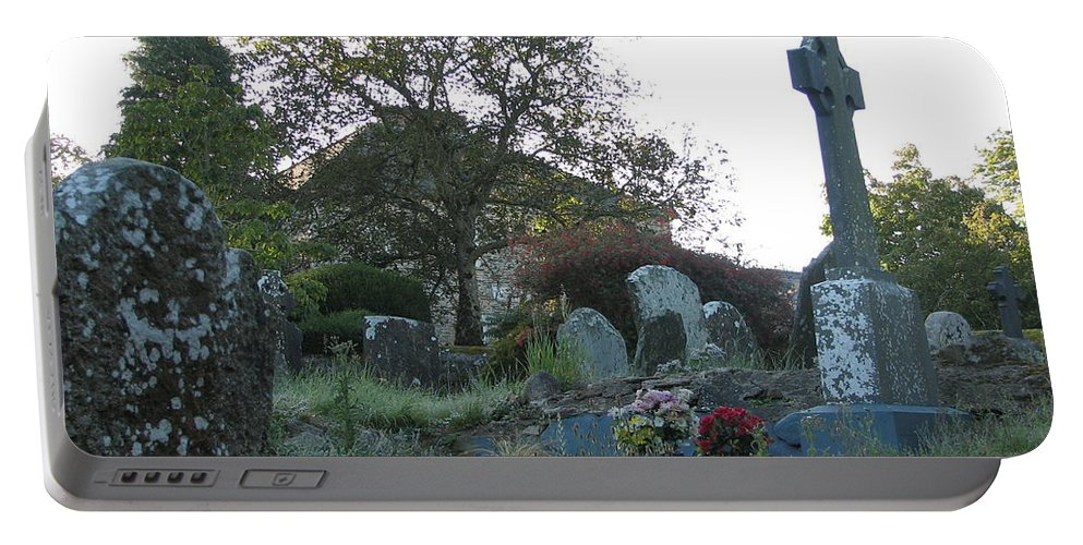 Graveyard Portable Battery Charger featuring the photograph Kilmokea Graveyard by Kelly Mezzapelle